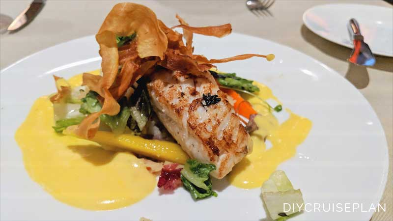 Fish dinner with garnish and sauce at 150 Central Park on Royal Caribbean Symphony of the Seas