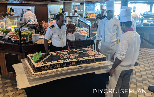 Three chefs around a very large cake that reads Thank You for Cruising With Us on Royal Caribbean Serenade of the Seas 2018
