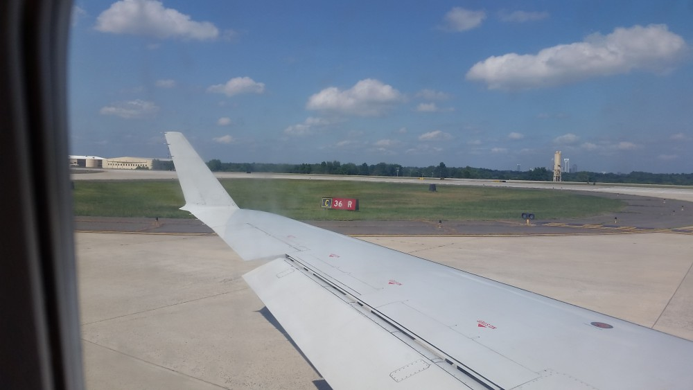 Airplane wing on taxiway