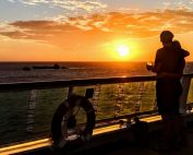 Couple on ship at sunset, Royal Caribbean Serenade of the Seas (c) 2018 Alyce Meserve