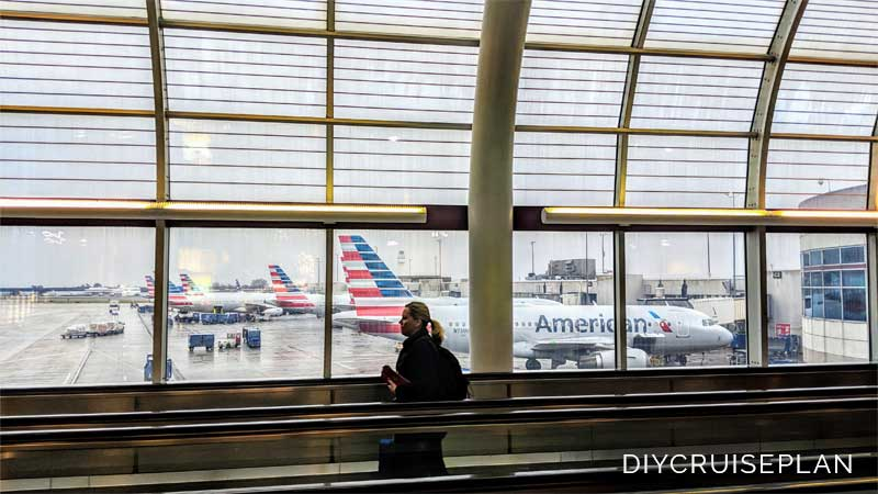 American planes at terminal in Charlotte NC on rainy day copyright 2018 Alyce Meserve